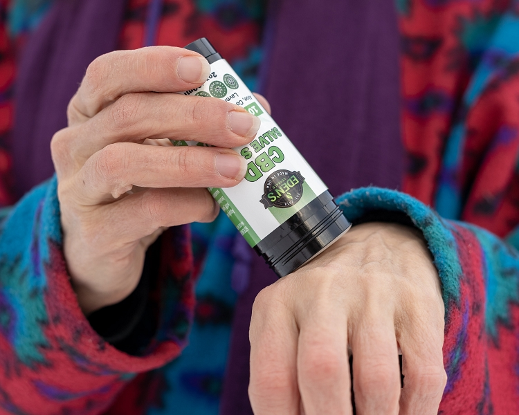 Woman using cbd lotion for arthritis relief
