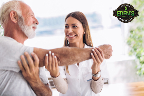 Older man getting massage with CBD lotion