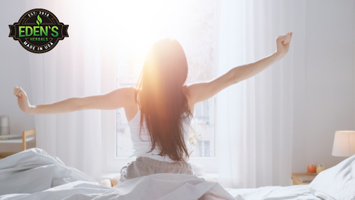 Woman stretching after a great nights sleep from taking CBD