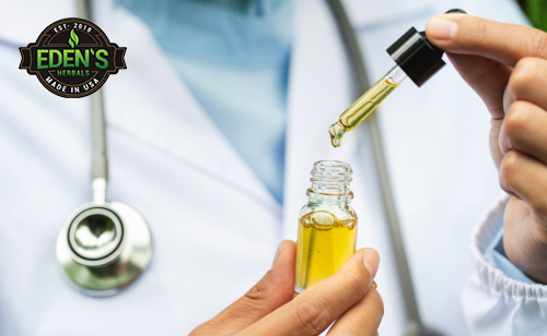 Doctor holding CBD oil tincture ready to administer