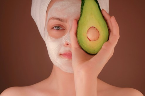 Woman with DIY avocado face mask