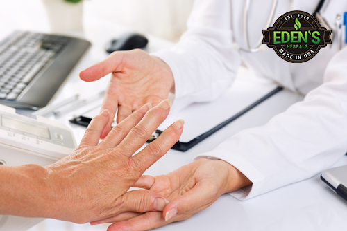 Doctor treating hand pain with CBD