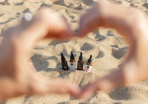Hands making CBD tincture heart