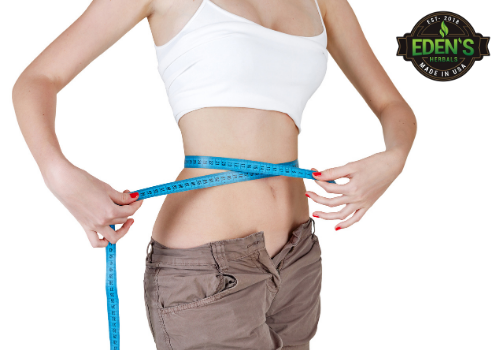 Woman checking weight loss progress from CBD tinctures