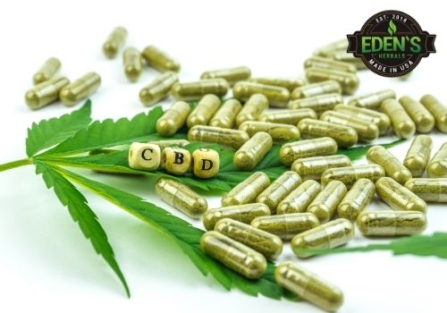 CBD pills and capsules on table