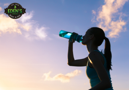 Woman drinking CBD water for fitness