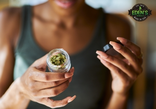 Woman holding jar of marijuana