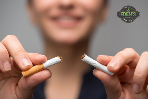 Woman breaking cigarette in half to quit smoking