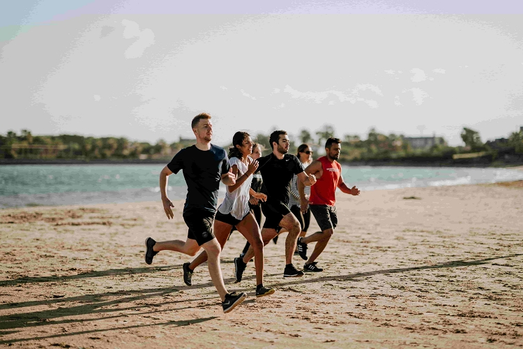 Runners on a beach racing