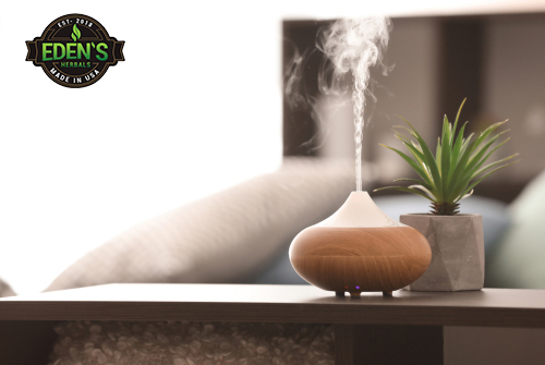 oil diffuser emitting aroma therapy vapors into bedroom