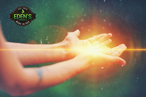 Hand holding energy from all natural healing